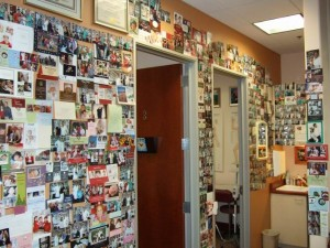 Fertility Success with Dr. Lee with acupuncture and herbal treatments. Right side of reception wall filled with baby photos.
